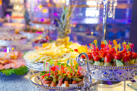 Delicacies and snacks at a buffet or Banquet. vegetables snacks: cucumber, tomato