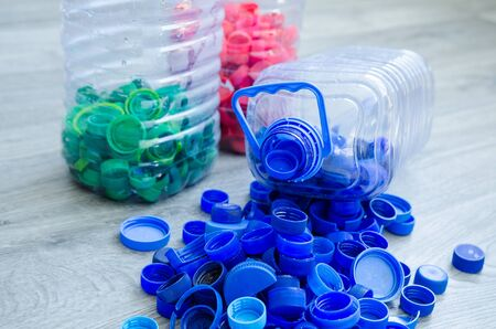 Selective focus, plastic bottle for recycle waste, Waste separation concept. waste recycling. Colored bottle caps