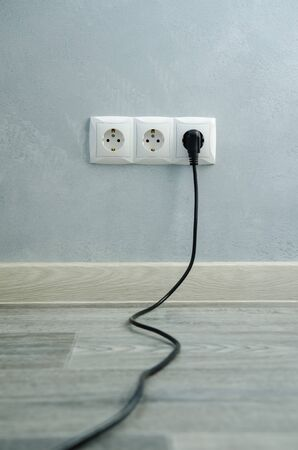 Close-up view of electric outlets with power cables
