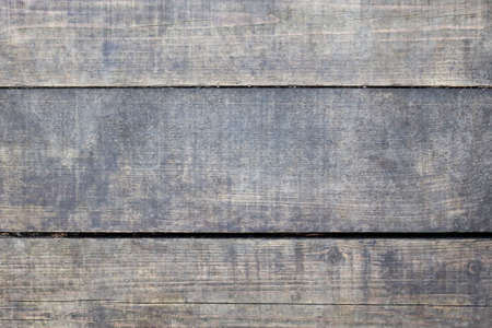 Shabby planks with natural wood texture. Three horizontal dried wooden boards. Template background for banner with copy space. Monochrome gray with shades of blue color