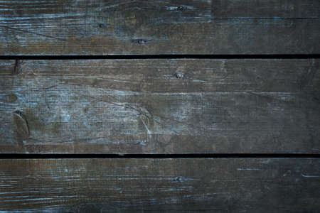 Vintage wooden planks with turquoise shade, dark moody. Horizontal texture dried boards. Template background for banner with copy space. Monochrome gloomy gray, vignetting