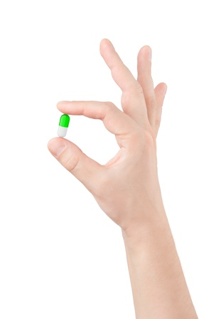 take medicine: pill in hand on white background Stock Photo