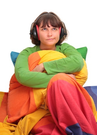 anti noise: girl in bed with headphones Stock Photo