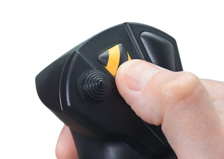 shambles: Finger presses on button of the joystick Stock Photo