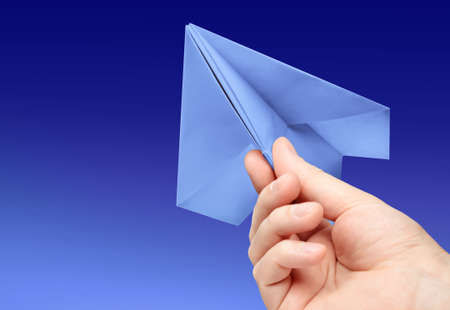 launch vehicle: paper plane in hand on background blue sky