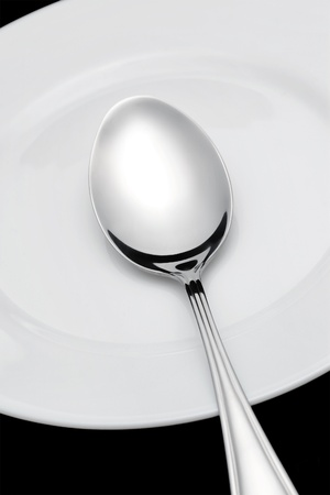Spoon is on the plate Stock Photo