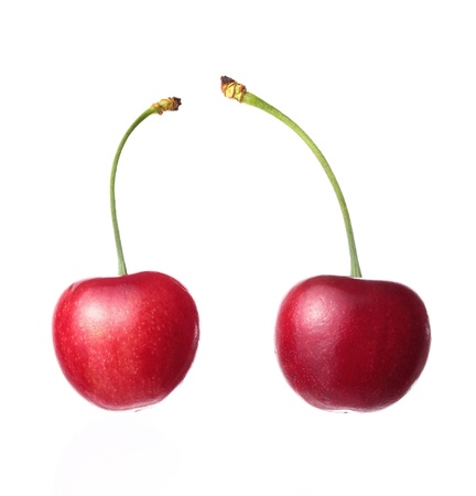 Two cherries on a white background
