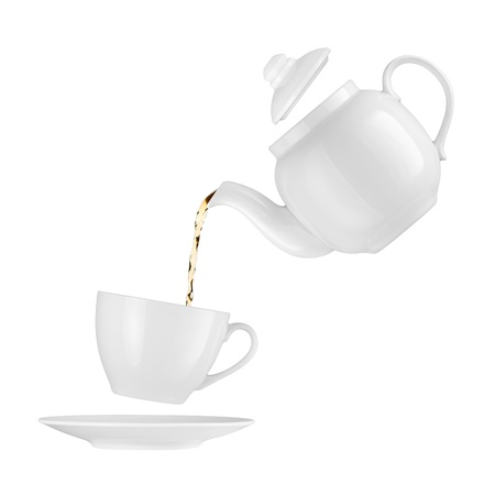 teatime: Teapot pouring tea into a cup on a white background Stock Photo