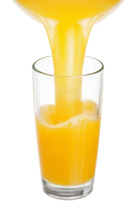 Fresh juice is poured into a glass photo