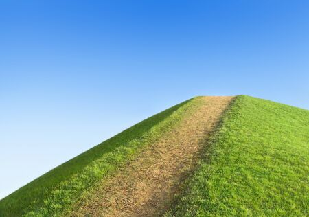 rural development: Pathway up the hill against the sky. Symbol development or career growth