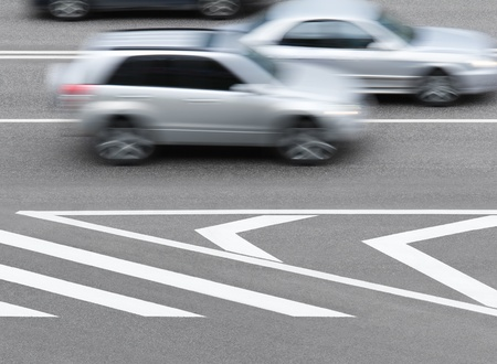 Road markings and cars. Abstract background. photo