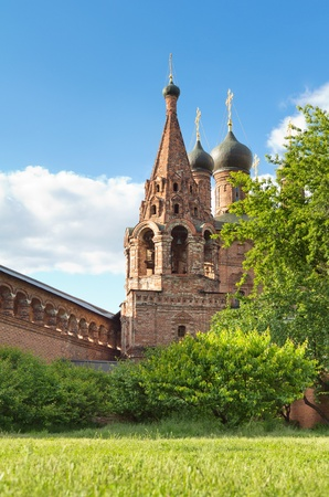 godly: Ancient orthodox temple against the blue sky. Krutitskoe Compound in Moscow.