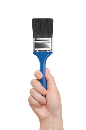 brush in a hand on a white background