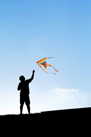 flying kite: Launching a kite in the sky. Silhouette of a man.