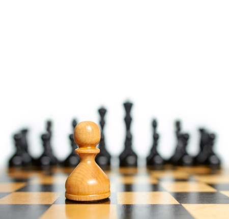 chess board: Chess. White pawn against black pieces Stock Photo