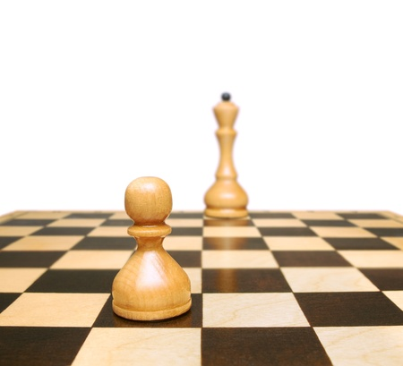 Chess. Pawn and queen. Symbol development or career growth. photo