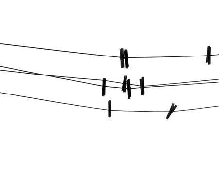 Clothespins on the rope. Silhouette on white background. photo