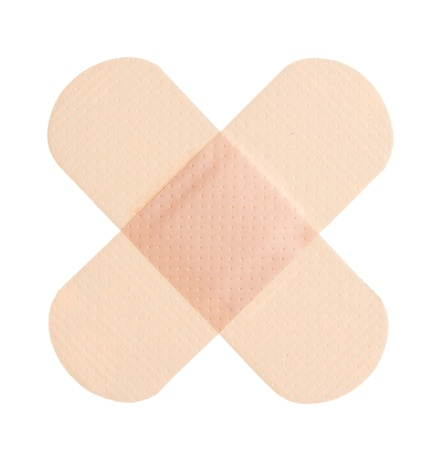 Adhesive bandage on a white background photo