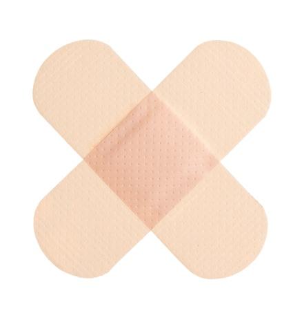 firstaid: Vendaje adhesivo sobre un fondo blanco Foto de archivo