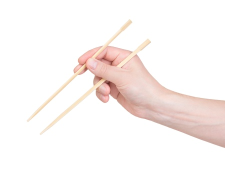 chopsticks in hand on a white background photo