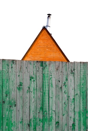 roof of a house with a pipe behind a wooden fence Stock Photo - 18423624