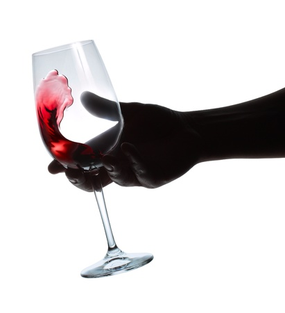 weinverkostung: Weinprobe. Ein Glas Wein in der Hand. Lizenzfreie Bilder