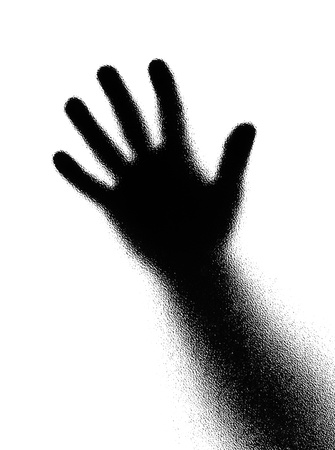Open hand. Silhouette on white background. Photographed through the textured glass. photo