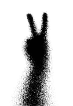 vanquish: Victory. Gesture of the hand. Silhouette. Photographed through the textured glass. Stock Photo