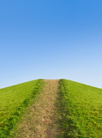 Pathway up the hill against the sky. Symbol development or career growth photo