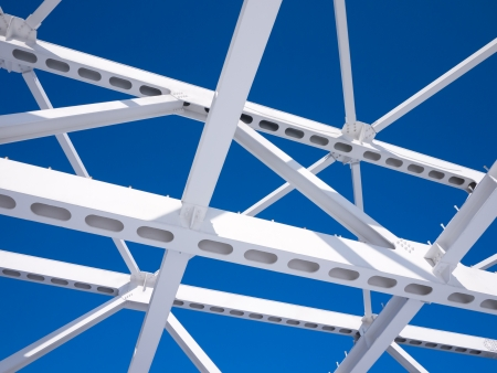Steel beams against the blue sky  Fragment construction site  Stock Photo