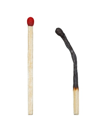 reverence: burnt match and a whole red match on a white background