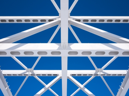 Steel beams against the blue sky  Fragment construction site  Archivio Fotografico