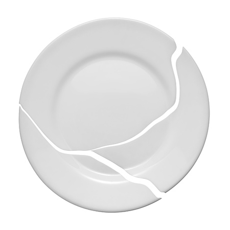 Broken plate on a white background  Metaphor of a family quarrel