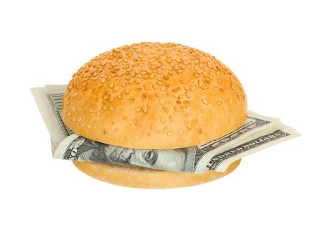 白い背景の上のお金でサンドイッチ 写真素材