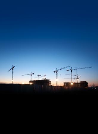 夕空に映えて建設現場 写真素材