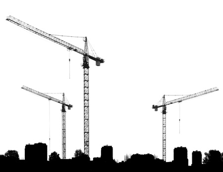 Construction site with cranes and silhouettes buildings on a white background photo