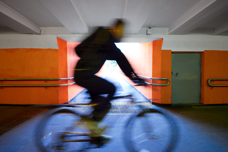 underpass: cyclist rides through the underpass