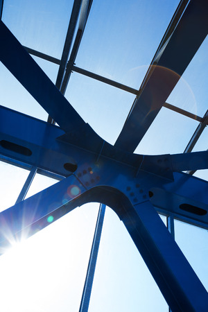 structural: Steel beams with solar flare. Fragment modern construction. Stock Photo