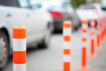 Orange bollards on the road