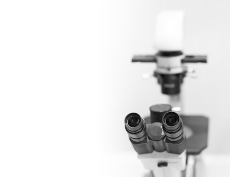 electrons: microscope in the laboratory, background with a field for text Stock Photo