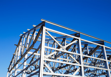 structural: metal frame of the roof against the blue sky