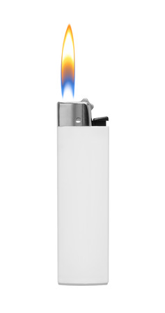 Lighter with fire on white background photo