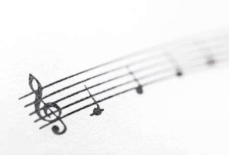 musical score: Music notes on paper. Fragment of the C major gamut. Stock Photo