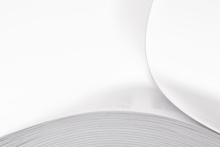 bending stack of paper, a fragment of a book or magazine photo