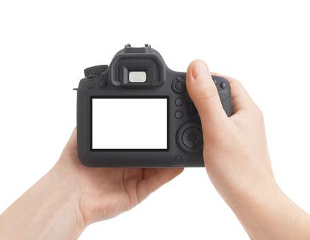 Camera in hand on white background Archivio Fotografico
