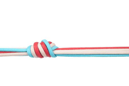 string together: Ropes or shoelaces tied in a knot on a white background