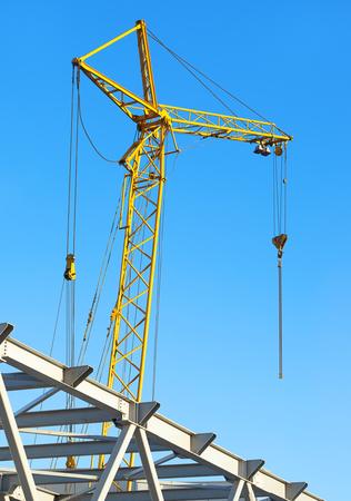 heavy joist: hoisting crane against the blue sky