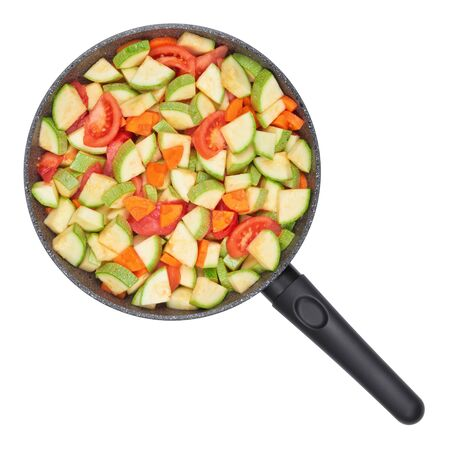marrow squash: Vegetable ragout. Zucchini and tomatoes with carrots in a pan.