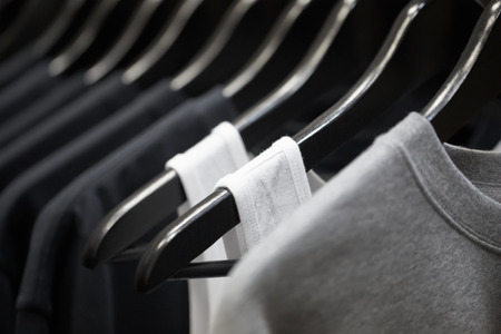 racks: sports clothing on hangers, abstract background