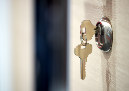 鍵穴にキー 写真素材